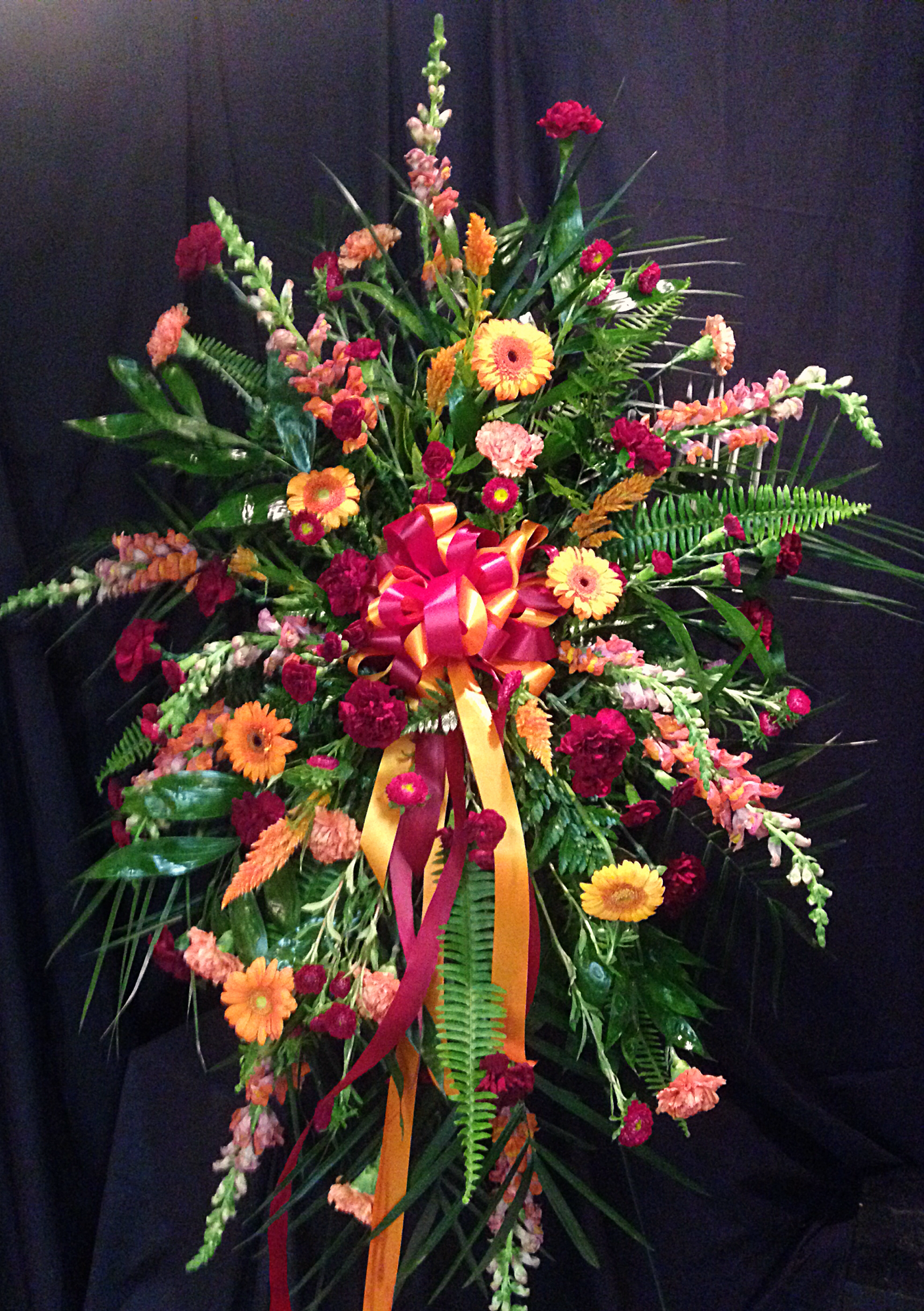 Virginia tech standing funeral spray with orange and maroon this is a funeral spray for a virginia tech fan that includes burgundy and orange carnations izmirmasajfo