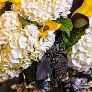 black seeded euc yellow calla white hydrangea centerpiece wedding