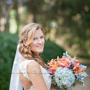 blue hydrangea coral rose wedding bouquet