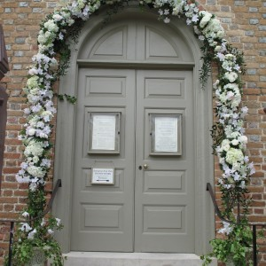 This wedding was a very Colonial Williamsburg wedding with the location being Bruton Parish, right in the heart of downtown Colonial Williamsburg. This bride and groom wanted us to erect an arch around the naturally occurring archway on the doors of Bruton Parish. We continued to use the wedding palette of white and erected this arch right outside the doors for their wedding guests to enter and exit.
