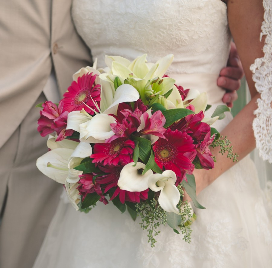 This bride and groom had a fuchsia or hot pink wedding palette. To accommodate the bride for her bridal wedding bouquet, we used fuchsia or hot pink gerber daisies, fuchsia or hot pink alstromerias or Peruvian lilies, white calla lilies and white lilies.