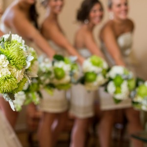 This bride wanted her wedding to be simple with a green and white palette. For her wedding bridal bouquet, we used green fuji or spider mums and white hydrangeas with silver lamb's ear leaves.
