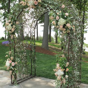 This bride and groom wanted a floral wedding arch as a back drop to their wedding vows. We kept to the bride's color palette and used peach roses and spray roses, peach stock and white hydrangeas and silver greens to fill in this full arch.