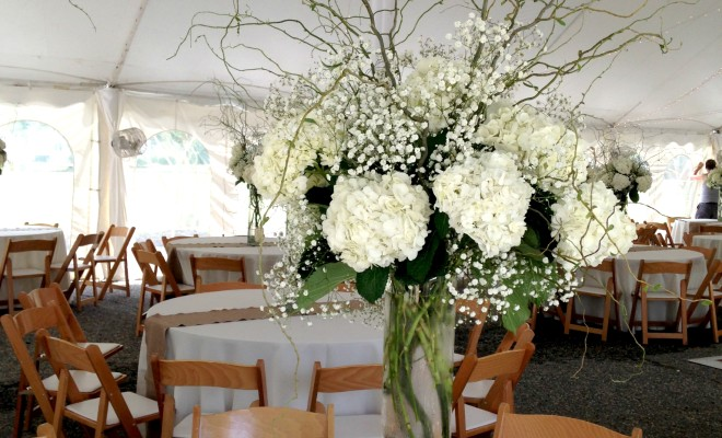 Tall white wedding centerpiece with babys breath white hydrangea ...
